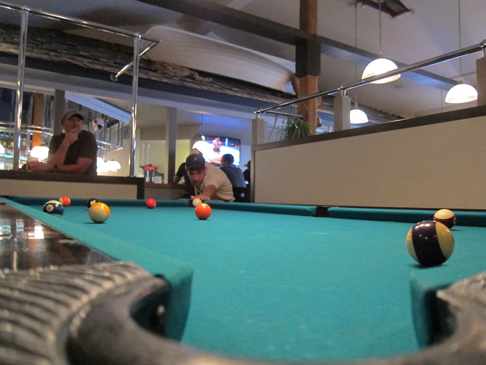 Playing pool at bar in Port Hardy BC