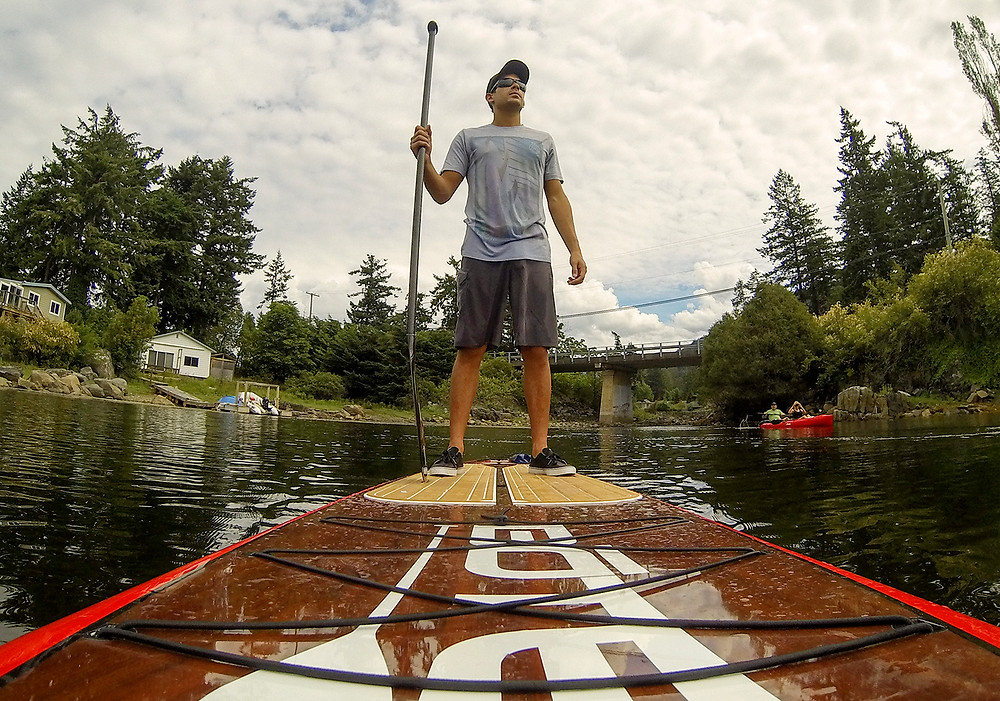 man paddle boarding though Madeira Park BC