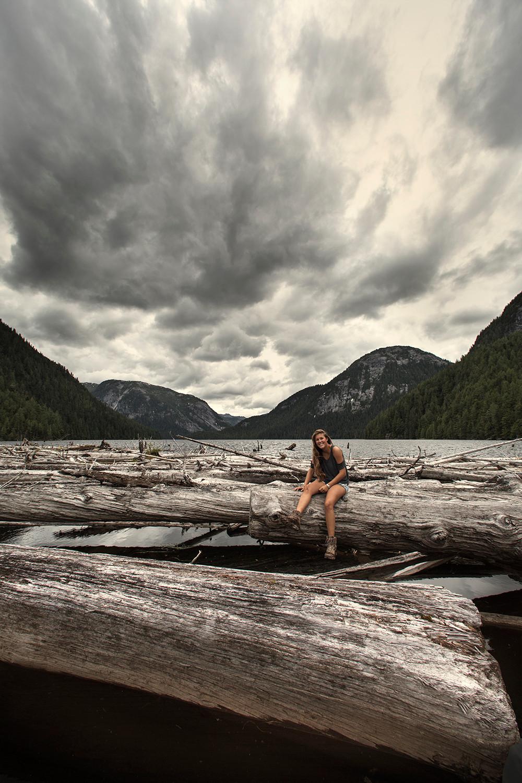Girl on Log lake Butedale BC