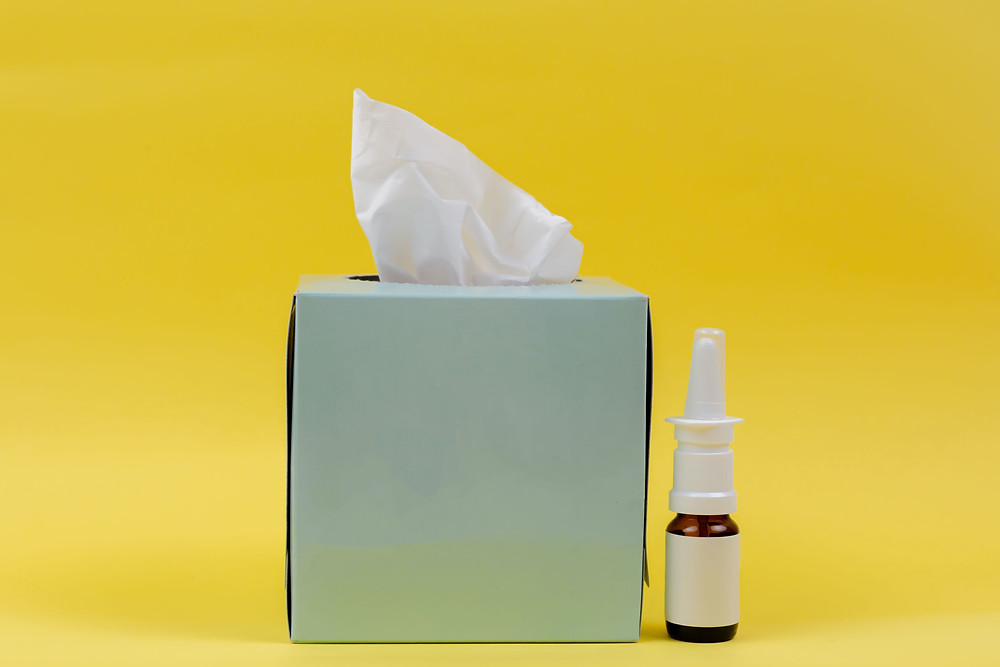 Photo: box of tissues and medicine for treatment of hay fever