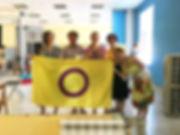 Няшные люди с интерсекс активисткой и флагом