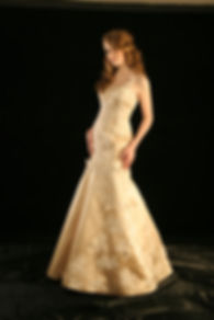 Woman in fit and flare gown by Victoria's Bridal