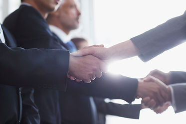 Multiple people giving handshakes