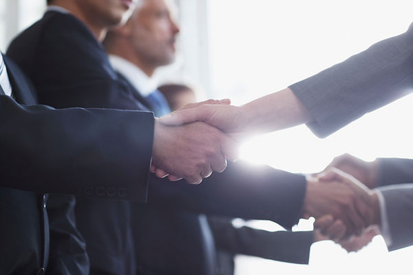 Fujitani Consulting, shaking client hands