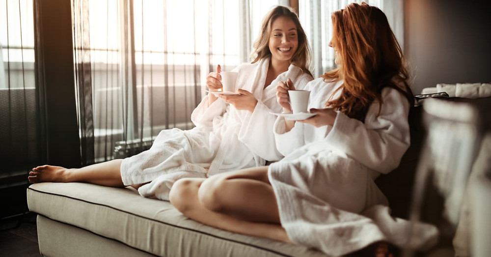 Two friends happy chatting at the spa