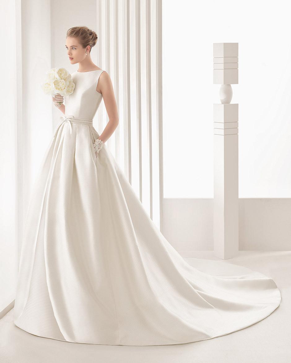 vestido novia minimalista corte a bolsillos