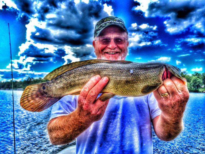 Facebook - The Dogger! Captain Krusty with a BowFin, feisty fighter!