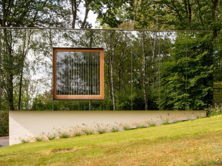 MIA Architecture's office blends into the landscape with a mirrored facade