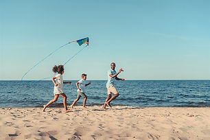 Family flying kite on beach.jpg