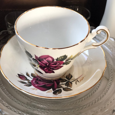 Assorted tea cups and saucer