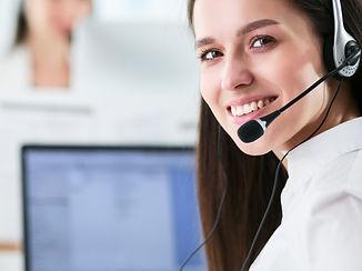 Smiling businesswoman or helpline operat