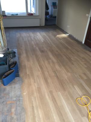 Renovatie Eiken Tapis vloer, geschuurd en behandeld met Loba HS 2K Impactoil Transparant