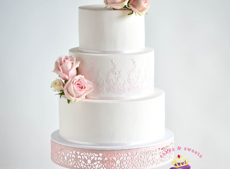 White Wedding Cake with stenciled details