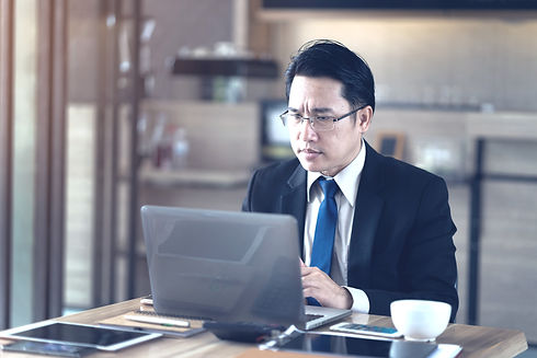 Business consultant is using laptop for calculate a return of investment to support his decision bef