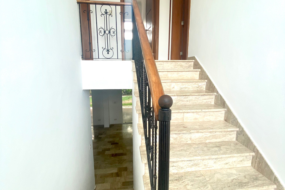 rogelio realtor escalera.JPG