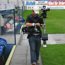 Steadycam Basson Steady camera stabilizer with digital cinema camera, customer photo, football field stadium from Europe