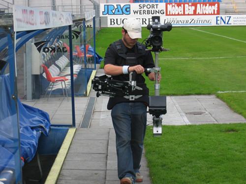 Steadycam Basson Steady camera stabilizer with digital cinema camera, customer photo, football field stadium from Europe