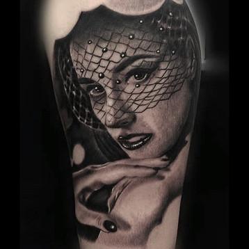 pinup-girl-sexy-tattoo-jammestattoo-stud