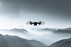 drone-flying-over-foggy-and-snowy-high-h