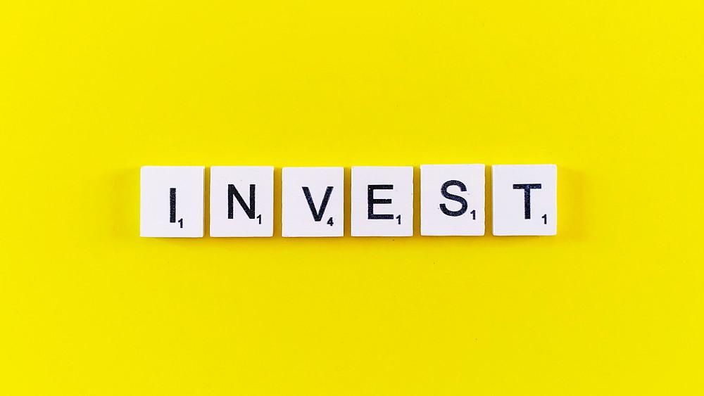 Invest word Graphic Design Branding Rolley Logo