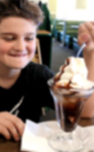 Little Boy with Chocolate Ice Cream Sundae