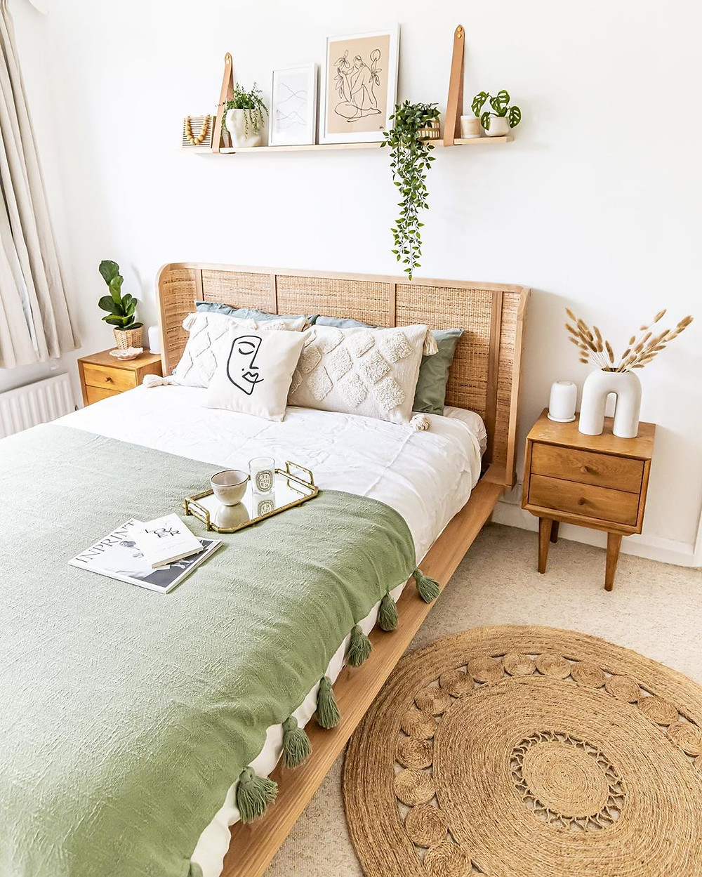 boho bedroom with rattan wooden bedroom, plants, and green bed sheets