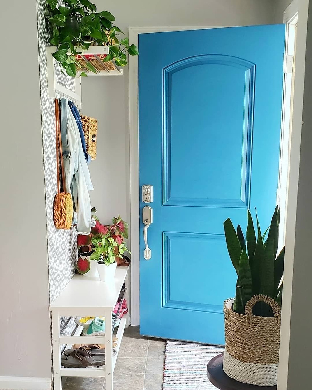 blue front door entryway decor with boho decorations and plants
