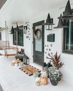 exterior design with black door and halloween decoration