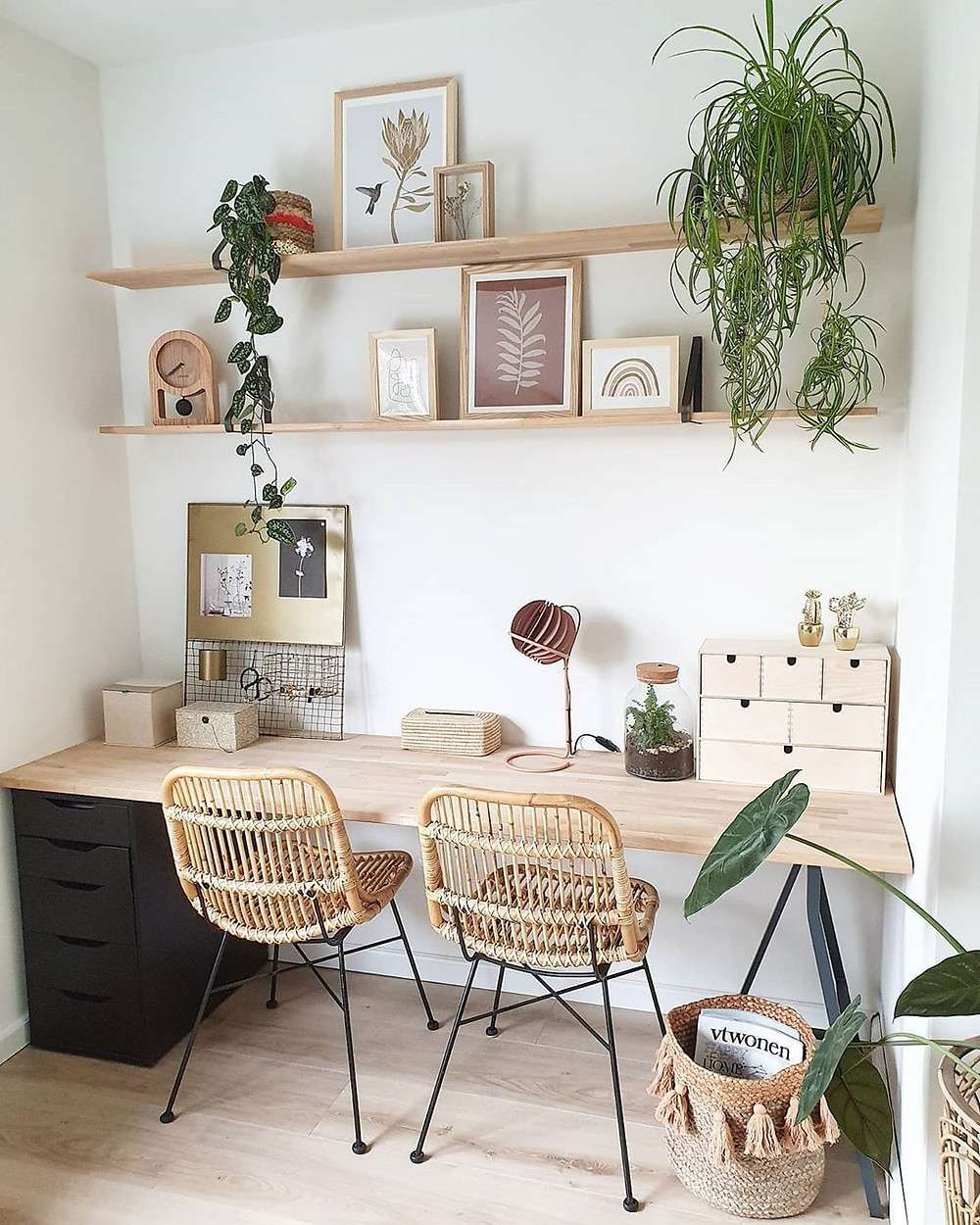 bohemian wooden work from home office with decorations on shelves with plants
