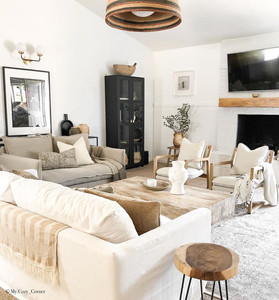 neutral living space with wooden furniture