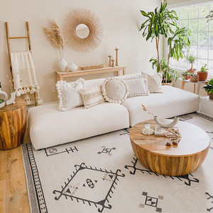 bright and sunny living room with wooden coffee table