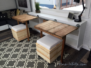Fold-down storage bench opened up to create two separate tables and seating areas in a tiny home design