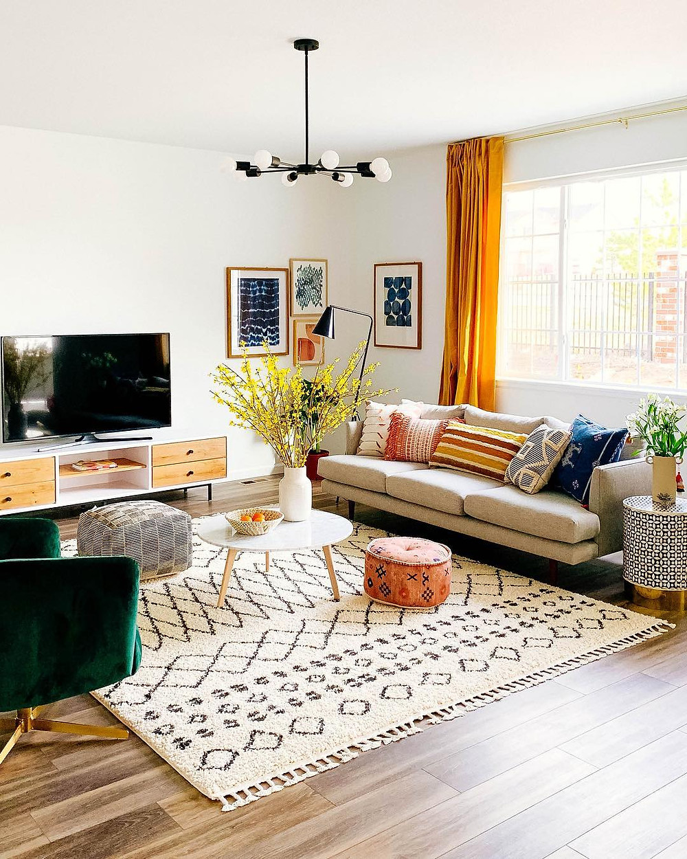 Colorful home decor in bold interior design living room with mix and match colors, patterns, and textures