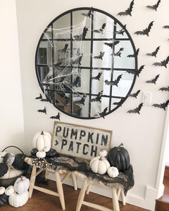 plaid circle mirror with halloween decorations and signs