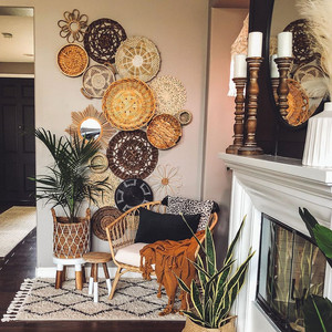 cozy corner in home with hanging rattan objects and cozy natural chair and plants