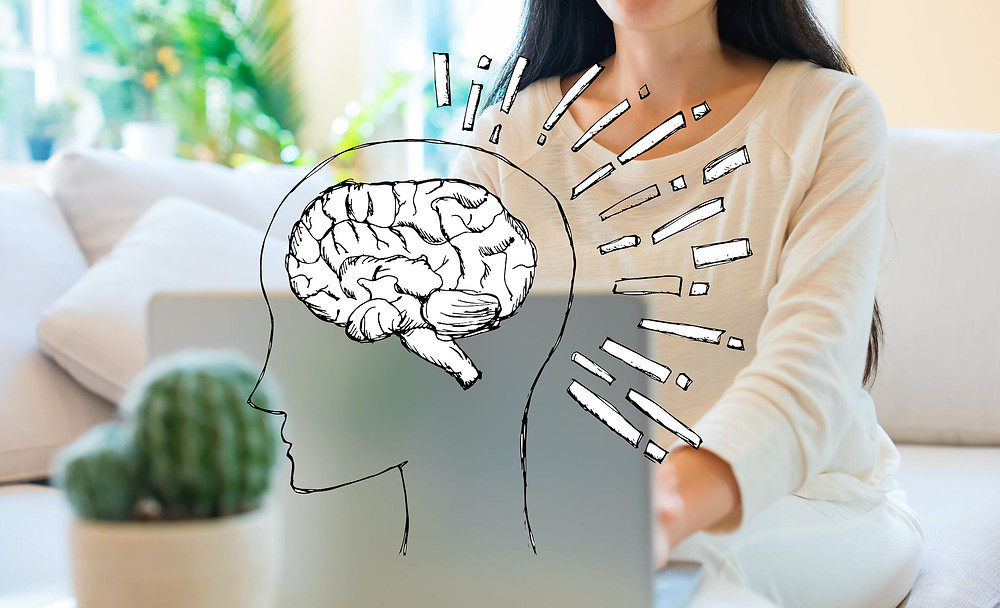 brain illustration and woman using laptop in living room