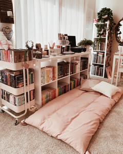 pink throw bed by cozy reading books area