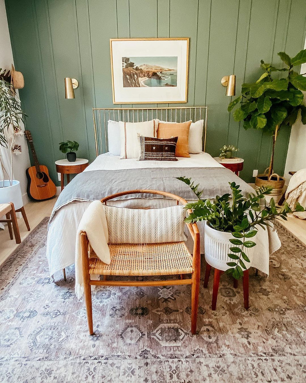 stunning boho bedroom with green walls, golden bedroom frame and plants