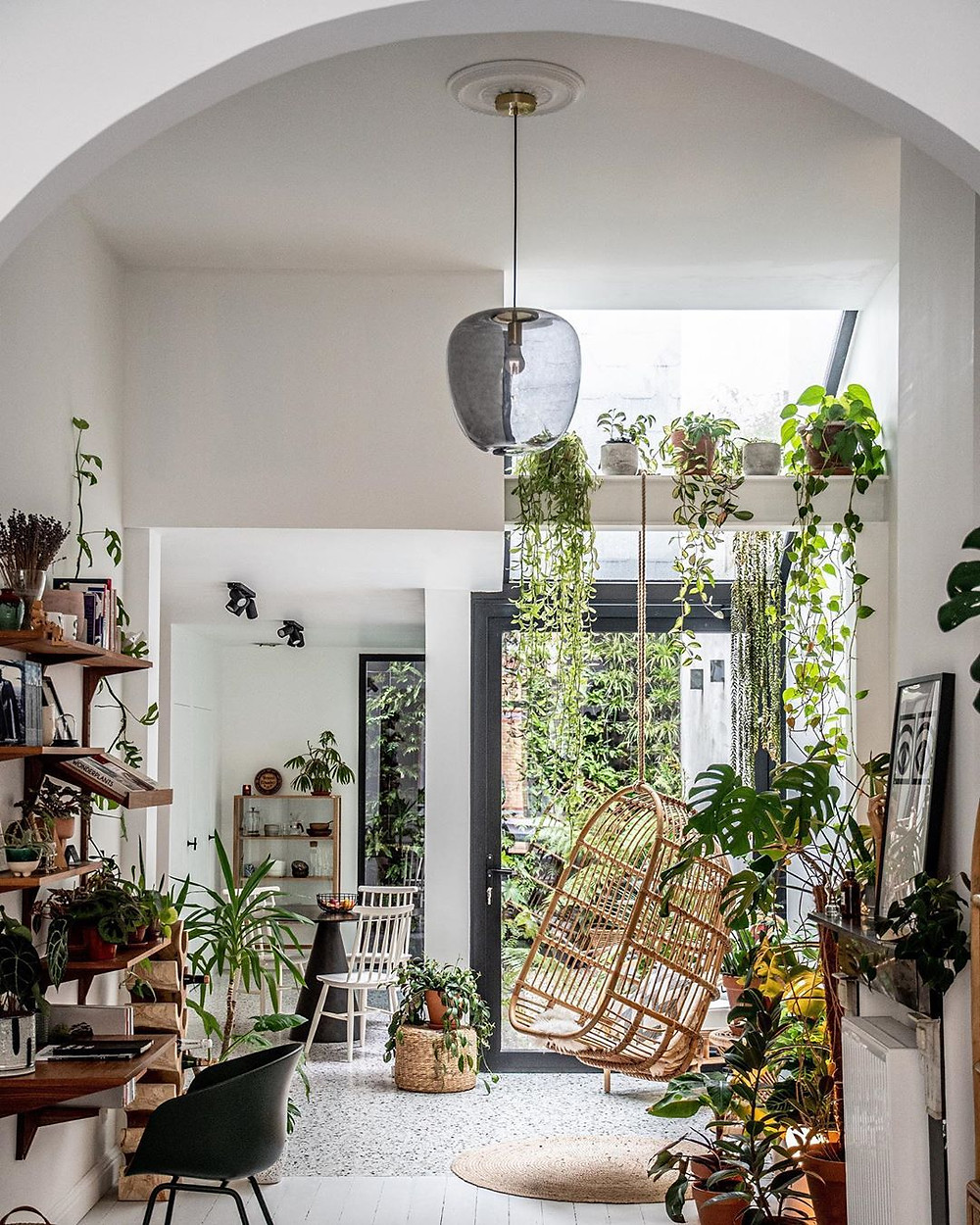Hilton Carter's plant filled home with rattan hanging chair and stunning interiors