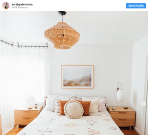 Boho home decor in an all-white bedroom with simple interior design pieces from Sarah Yates Mora Instagram