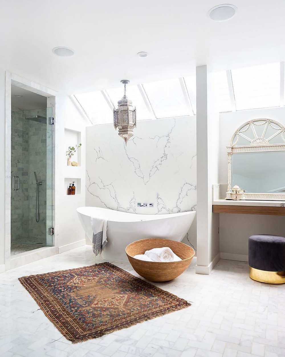 luxury bathroom and bathtub design with open white flooring and marble walls