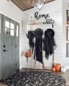 halloween entryway design with skulls rug