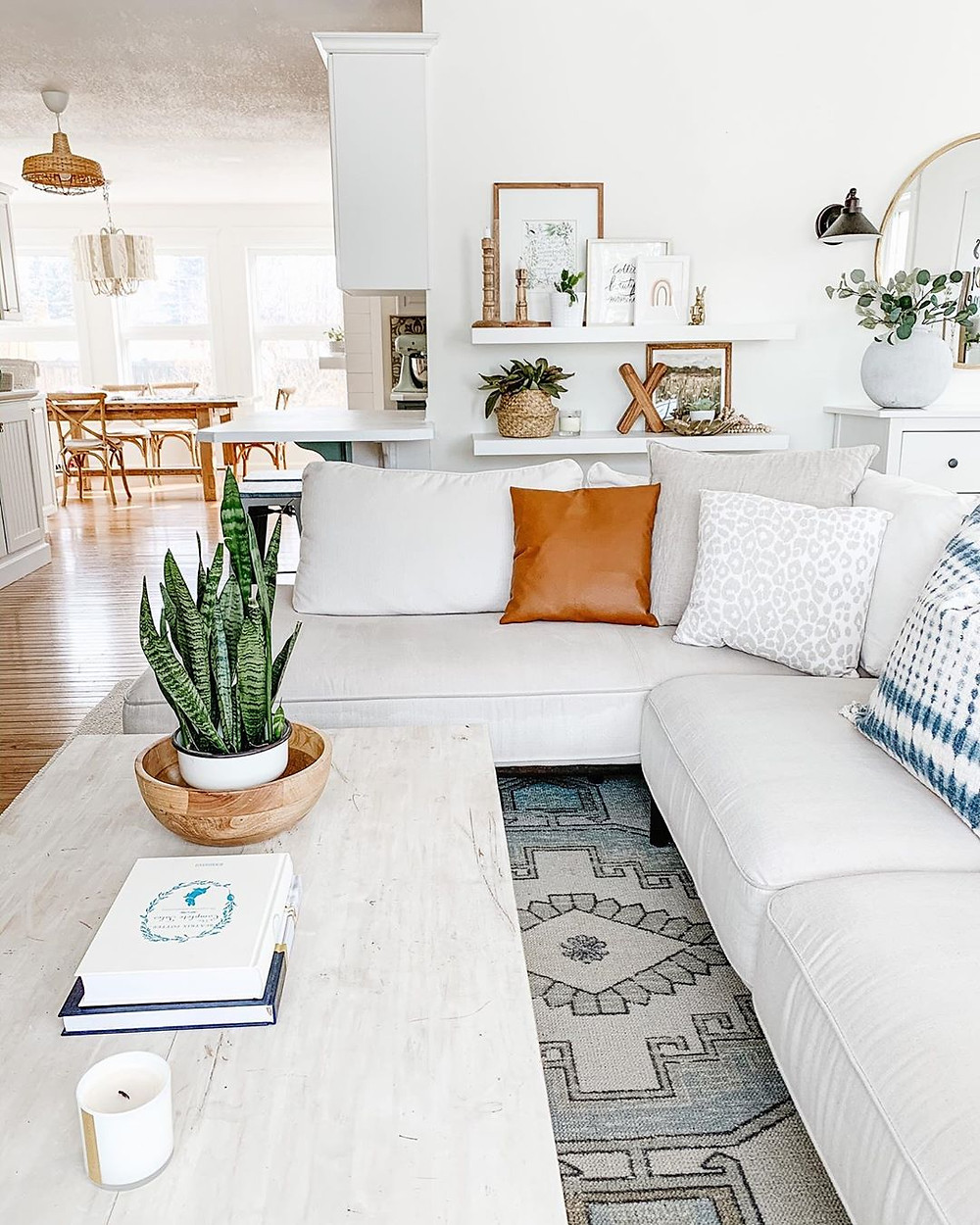 Farmhouse living room with ruggable rug, white sectional sofa and white coffee table