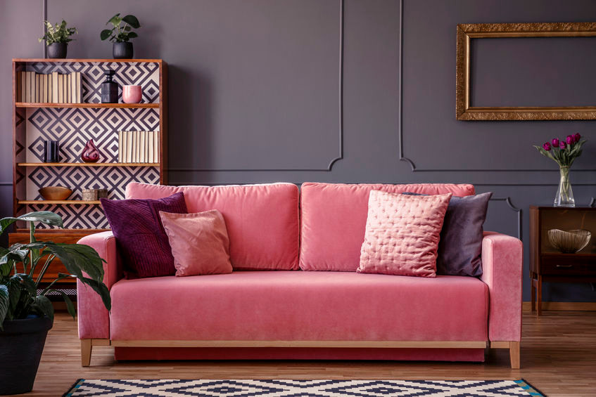 Art Deco interior design style with pink velvet sofa and jewel-toned home accents in living room