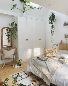 Scandinavian interior bedroom decoration with white furniture from ikea and natural rattan items