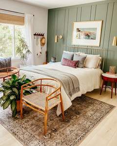 green headboard in boho bedroom decorated with natural wooden chairs and gorgeous rug
