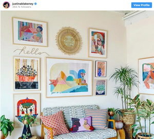 Colorful interior design with multiple patterns, colors, and textures in the living room from Justina Blakeney's Instagram