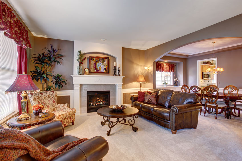 Traditional interior design with antique and classic art, furniture symmetry, dark wood, and ornate details