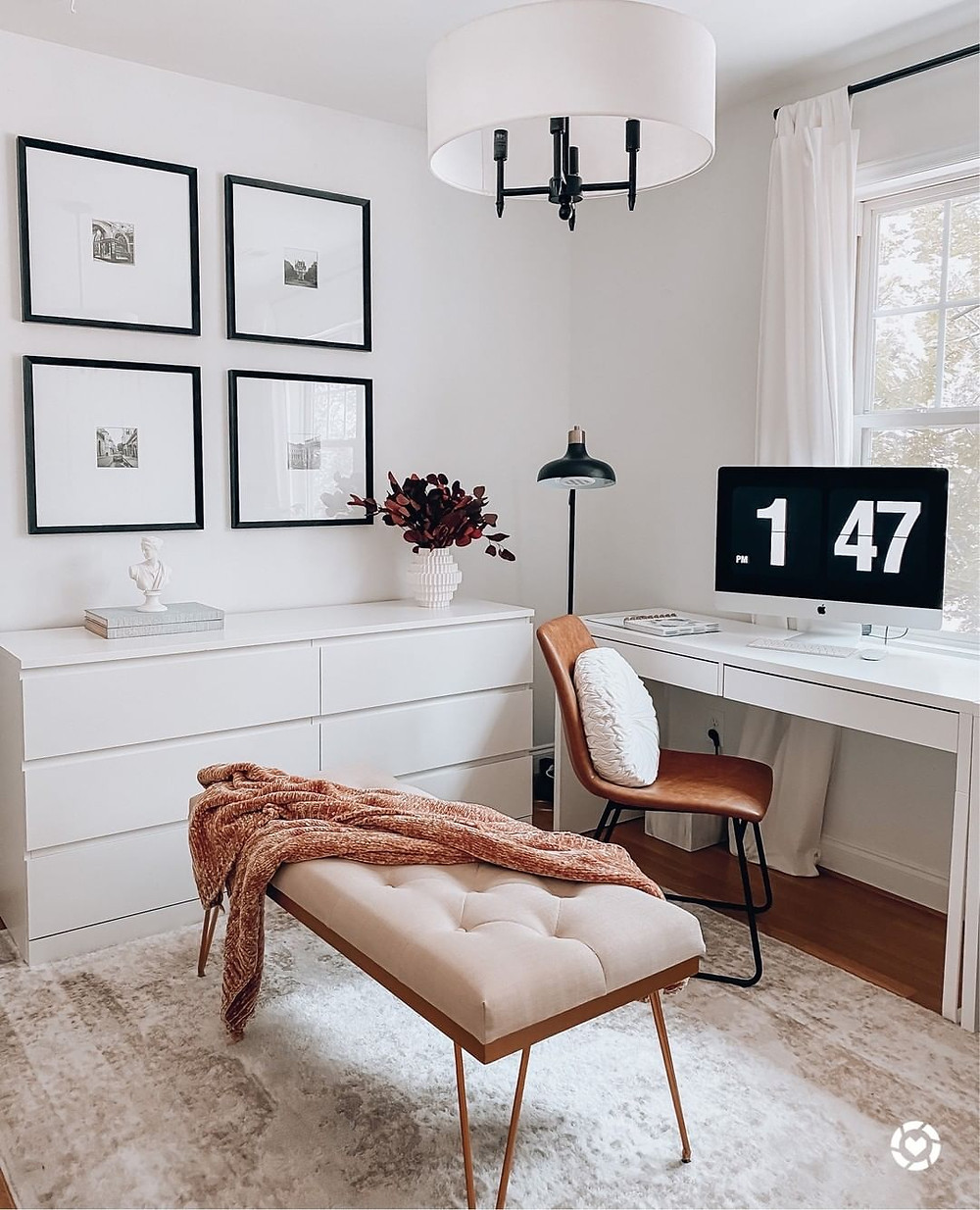 Simple Scandinavian home office setup with apple computer and decorative bench