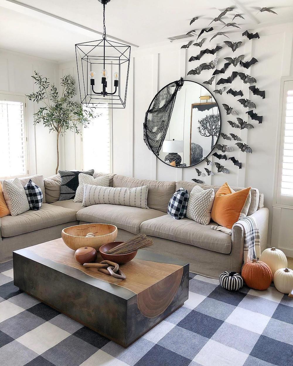 halloween living room decor with plaid rug and bat art